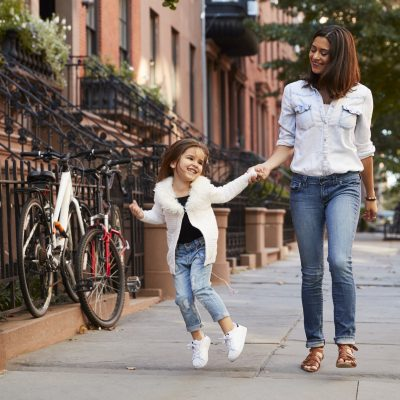 Mother And Daughter Walking Down The Street Pwjlfsu